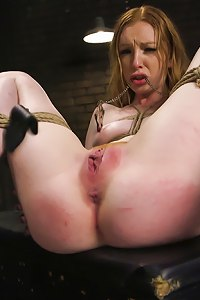 Super hot redheaded slave girl Katy Kiss is taught to be a better slut with diabolical predicament bondage, orgasm control and rough hard core sex.