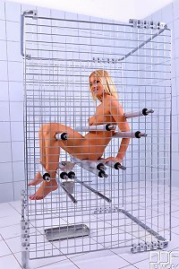Kiara Lord in cage shaved pussy