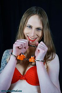 Mitzi in lingerie and high security handcuffed