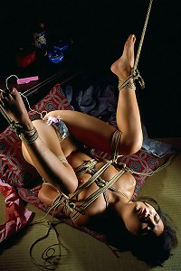 Traditional Hentai rope bondage done on a conservative and timid woman.