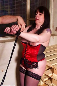 Mature slave in bondage action