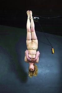 The blonde bondage lover is tied firmy in the softest hemp rope and then hoisted up to the ceiling where she