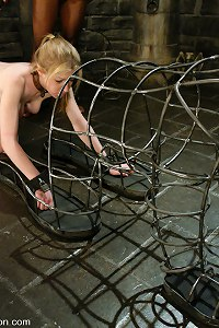Haley Scott endures bondage and gives head in a locked cage.