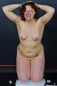 Amateur red haired subbie, Isabelle is tormented by her master and than sat on blocks of ice