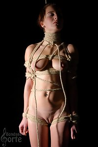 Holly tied in a shibari bondage