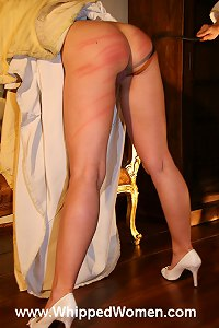 Historical role-play madam whips her slave