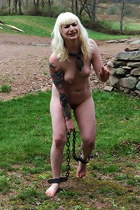 Shackled slave trained outdoor