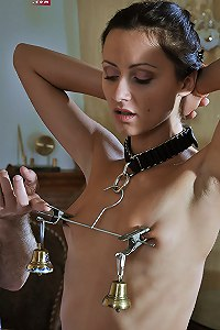 Slave tormented with weighted nipple clamps
