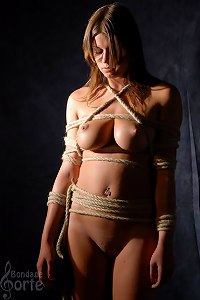 Hunged girl in the shibari style