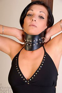 Sexy brunette in police handcuffs and steel chain
