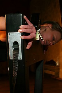 Women locked in stock and  whipped