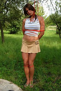 Smokergirl Monica tied in the orchard
