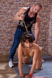Female slave candidate submits to master for inspection