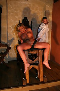 Busty blonde pussy flogged on Bdsm chair
