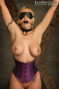 Big-boobed blonde in glasses, Mz Berlin, gets tied and gagged, blindfolded and forced to cum in the dungeon.