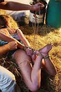 Master is using leash to drag slavegirl to the haystack where she is going to spend the night being hogtied  Submissed