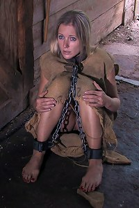 Helpless slave getting new shackles