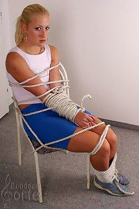 Blond girl tied with thick rope