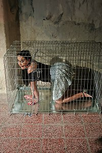 Slave gets caged by her master
