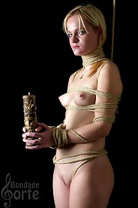 Tied girl with a candle