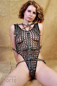 Chained girl in sexy dress