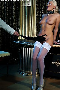 Blonde chick in stockings gently flogged