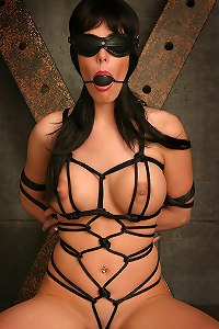 Blindfolded brunette in rope dress