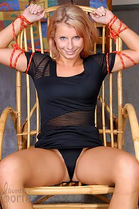 Tied Petula dildoed on the rocking-chair